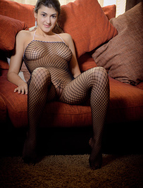 """Zita B poses in her fishnet lingerie that highlights her voluptuous body"""